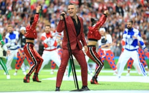 "Robbie Williams takes to the pitch to belt out his famous hit ""Let me entertain you"" which Fifa will hope this tournament will do"