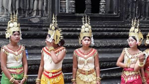 These girls had been posing with tourists at Angkor Wat, Cambodia, when I caught them in between 'jobs'.