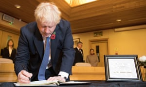 Boris Johnson signs a book of condolence for the Essex lorry victims
