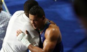 Anthony Joshua, left, consoles Joe Joyce after the latter's controversial defeat to Tony Yoka