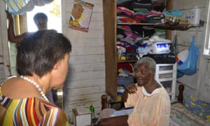 Patricia Scotland speaks to a local resident in Dominica.