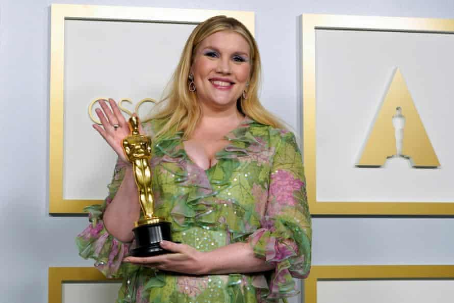 Emerald Fennell with her best original screenplay Oscar.