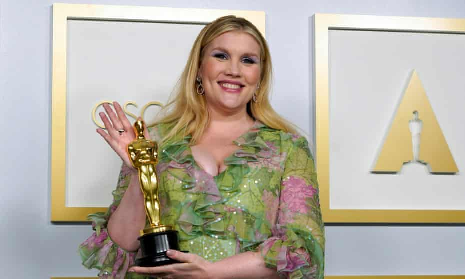 British actor/writer/director Emerald Fennell with her Oscar for best original screenplay for Promising Young Woman.
