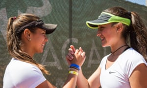 Two girls handshake t Rafa Nadal Tennis Centre at Sani Resort, Greece