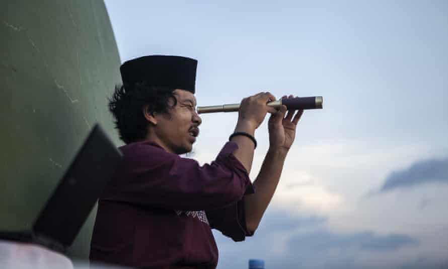 Indonesian Muslim trying to spot the new moon in Yogyakarta, Indonesia, on 23 April.