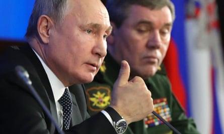 Vladimir Putin at an annual military meeting