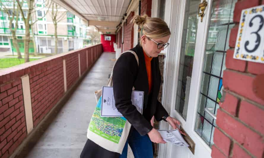 Katherine Gilroy drops off a leaflet