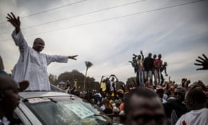 Gambian presidential candidate Adama Barrow greets supporters