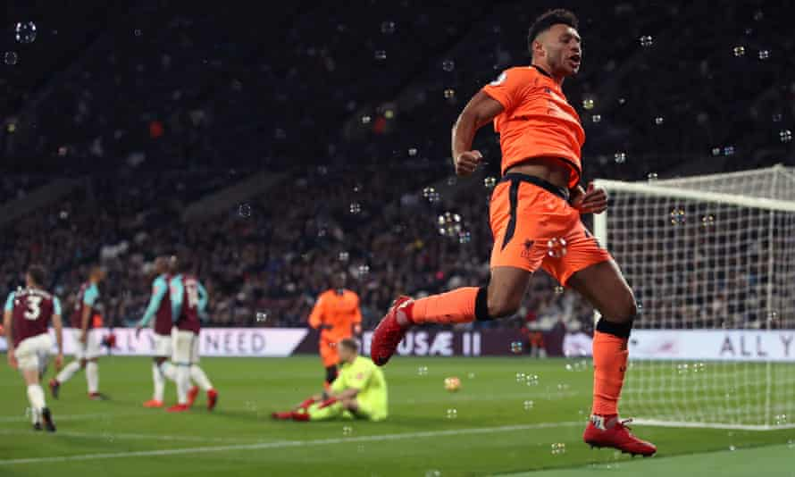 Alex Oxlade-Chamberlain celebrates scoring his side's third goal, which came moments after Manuel Lanzini had got West Ham back in the game.
