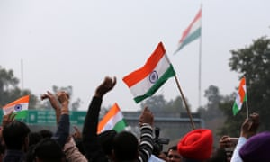 People hold Indian flags and shout patriotic slogans as they wait for the pilot Abhinandan Varthaman to arrive.