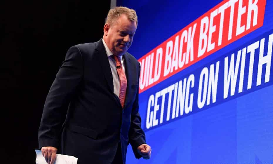Lord Frost leaves the stage after delivering his Brexit speech at the Conservative conference.