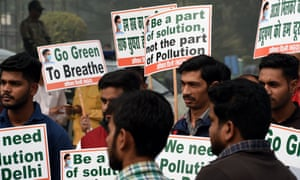Toxic air … Indian activists at a mask-distribution drive at the roadside in New Delhi in 2017.