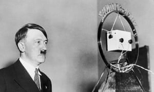 1933: Adolf Hitler makes his first radio broadcast as German Chancellor in front of a radio microphone.