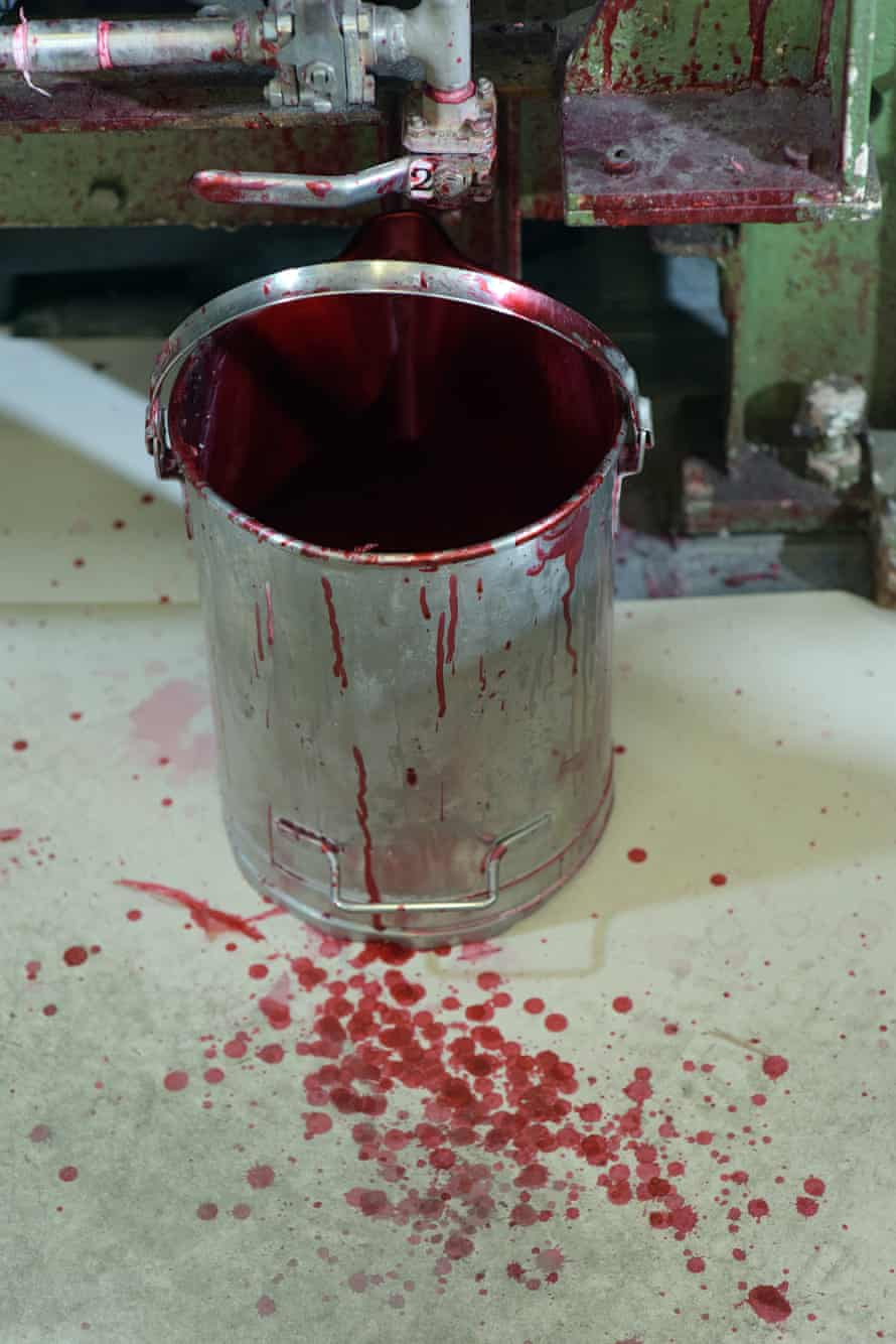 A bucket of chemical used in making the instant film.