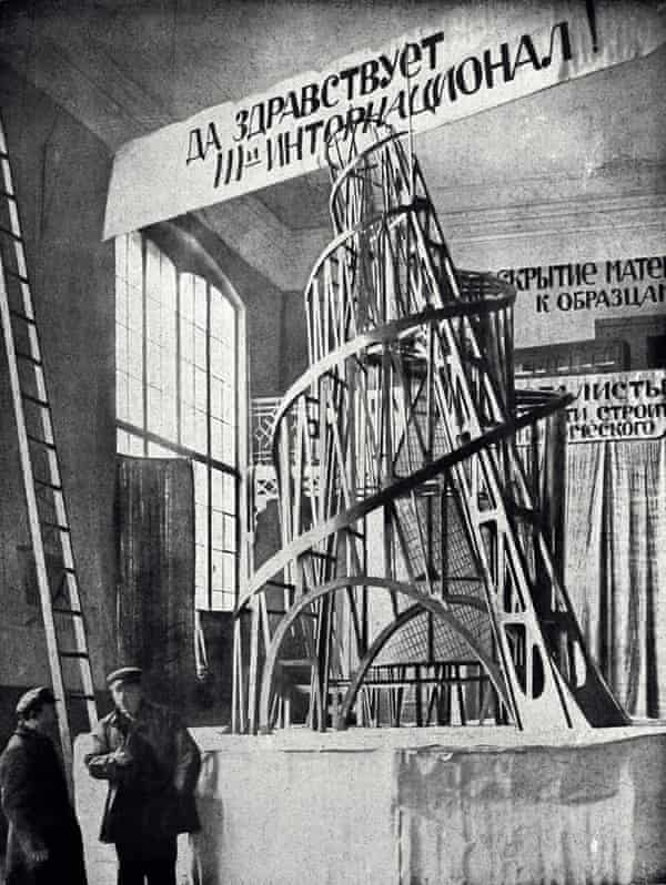 Tatlin with an assistant, in front of his Monument to the Third International, Petrograd.