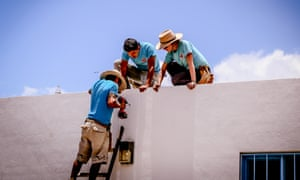 The Isla Urbana team start work to install a rainwater harvesting system. Plumbers are trained and hired from the communities in which the organisation works.