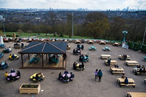Customers enjoy a drink at the reopening of the Terrace Bar at Alexandra Palace, London.