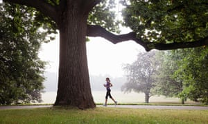 Woman jogging in suburban park