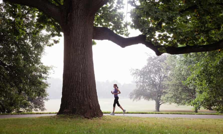 Woman jogging in suburban park