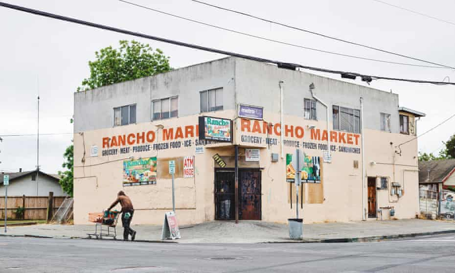 The Rancho Market store in north Richmond. A mural of gunshot victims used to blanket its wall until its owner recently decided to patch up the bullet holes and repaint the walls.