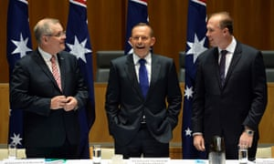 Australian social services minister Scott Morrison, prime minister Tony Abbott and immigration minister Peter Dutton after an inappropriate comment was made between the three ministers and broadcast via an overhead television microphone.