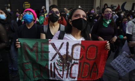 Feminist activists who have taken over the human rights commission building demonstrate in Mexico City, Mexico, on 14 September.