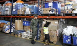 Sombra looks for drugs in the cargo hold of El Dorado airport in Bogota, Colombia, on 26 July.