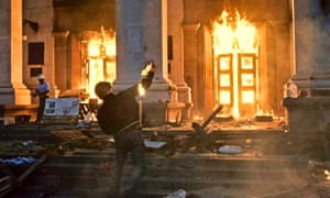 A petrol bomb is hurled at the burning trade union building in Odessa, Ukraine, in 2014.