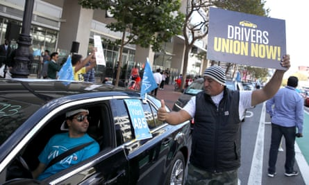 Rideshare drivers rally outside of Uber headquarters in San Francisco to support California Assembly Bill 5 and to demand the right to form a union.