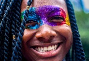 A man with rainbow glitter around his eyes