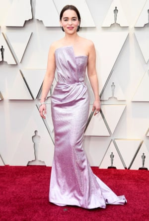 Game of Thrones star Emilia Clarke revealed she'd swapped her blonde lob for a brunette bob, teamed with a long lilac gown. Look closely and you can spot the GoT tribute tattoo on her right wrist