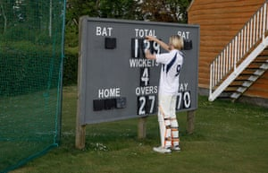 A batsman for Hambledon's third XI changes the scoreboard while waiting to bat against Portsmouth third XI at Broadhalfpenny Down.
