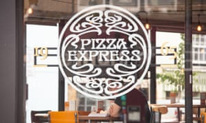 A customer dining at a branch of Pizza Express in London