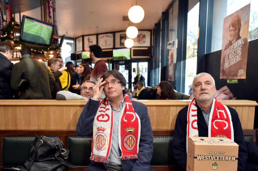 Former Catalan president Carles Puigdemont watches the Girona v Getafe match at a bar in Brussels.