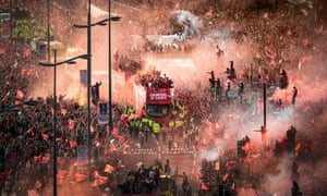 Liverpool players and staff are driven through the centre of the city in an open-top bus to celebrate the team winning the Uefa Champions League.