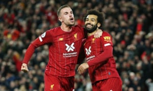 Salah celebrates with Henderson.