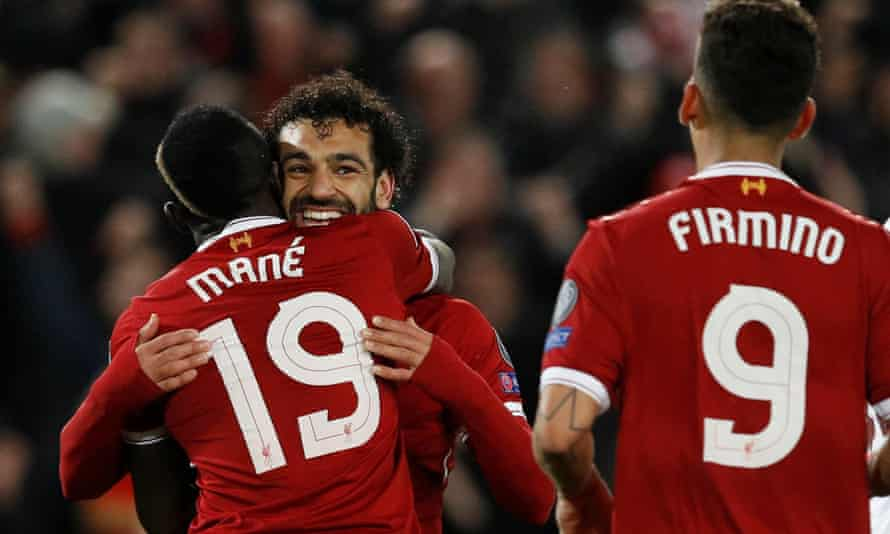 Sadio Mané, Mohamed Salah and Roberto Firmino celebrate Liverpool's third goal during their recent 5-2 victory over Roma in the Champions League.