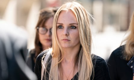 PC Andrew Harper's widow Lissie leaves the court after the sentencing of her husband's killers.