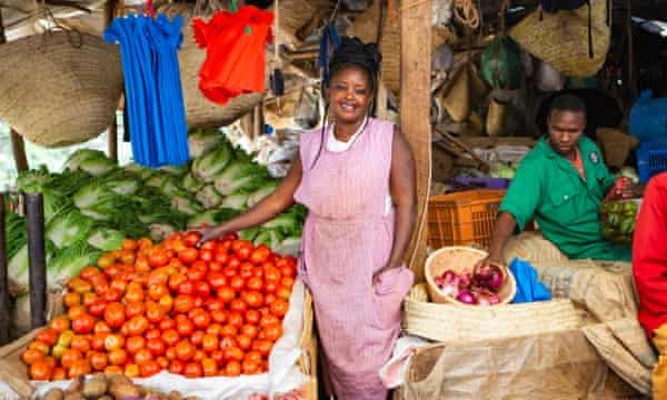 Nice Wambui at her produce stand in City Park market. With too much in stock and not enough buyers, her primary concern right now is business rather than coronavirus
