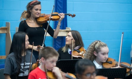 'Music fires the imagination in young minds': Nicola Benedetti works with primary school children in Raploch, Stirling, home to the first 'Big Noise Orchestra'.