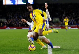 Brighton's Leon Balogun fouls Crystal Palace's Wilfried Zaha for a penalty.