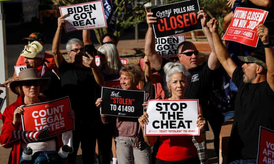 Supporters of Donald Trump hold signs during a protest about the early results of the 2020 presidential election, in front of the Phoenix City Hall, in Phoenix, Arizona, on 5 November 2020.