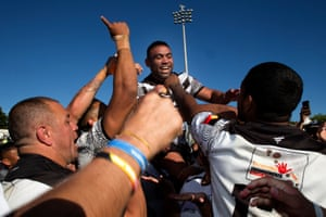 Redfern players celebrate after winning the grand final against Newcastle All Blacks