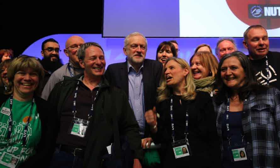 Jeremy Corbyn poses for pictures with teachers following his speech at the NUT conference in Brighton
