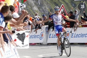 France's Thibaut Pinot celebrates as he crosses the finish line on the Tourmalet.