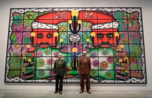 Collaborative art duo Gilbert and George pose in front of Beardmas which forms part of their new exhibition at the White Cube gallery in London