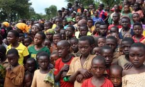 Burundian refugees listen to Tanzanian PM Kassim Majaliwa speak at Nduta camp in Kigoma, Tanzania.