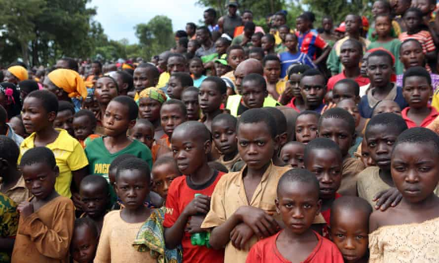 Burundian refugees listen to Tanzanian PM Kassim Majaliwa speak at Nduta camp in Kigoma, Tanzania.