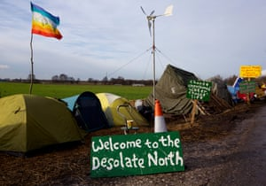 Signs at the anti-fracking protest camp set up at Barton Moss in Salford where energy company iGas has built a vertical test well to assess the suitability for shale gas tracking at the site between Barton Aerodrome and the M62 motorway