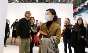 A woman wears a face mask while visiting the Armory Show in New York last month.